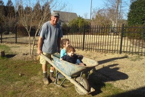 Owner Brian McCarthy and kids in wheelbarrow.